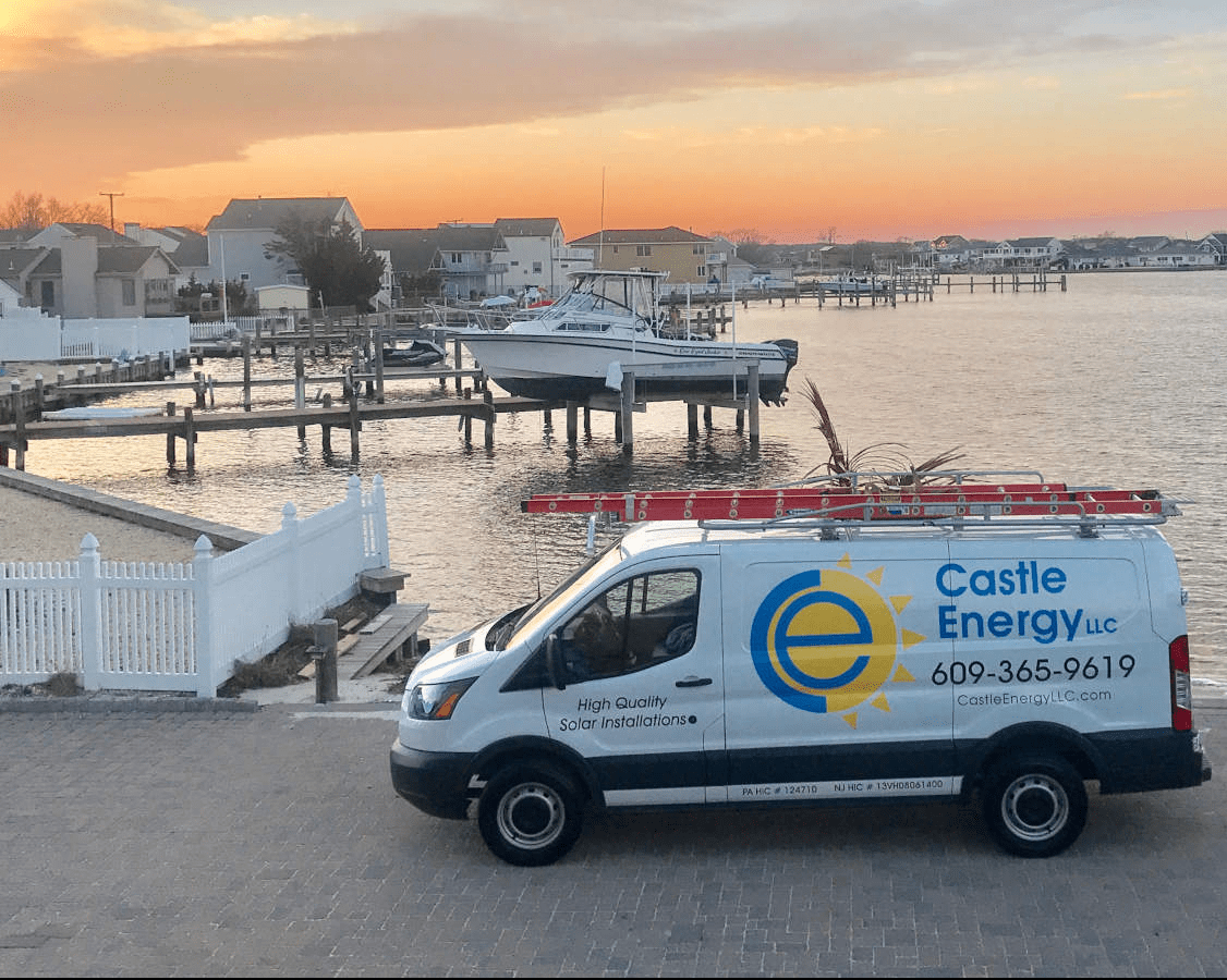 Castle Energy truck van parked in front of a bay during a sunset