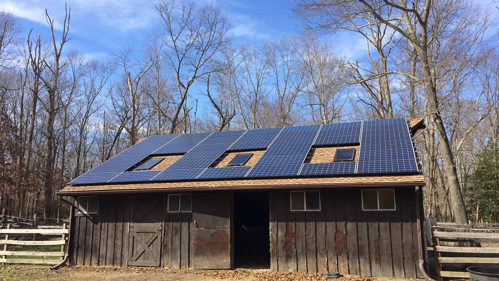 Roof mounted solar panels on a barn